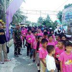 Personel Satgas Pam Puter Yonif 713/Satyatama Membaur Dengan Jemaat Marore
