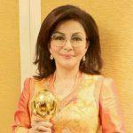 Bupati Minsel Tetty Paruntu Terima Penghargaan UHCA Dari Presiden Joko Widodo